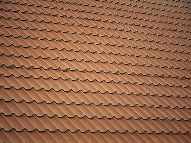 Which is better a metal roof or shingles?